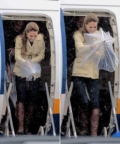 The Duchess of Cambridge struggling (adorably) with her umbrella as she gets pelted by the rain in Bella Bella.