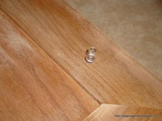 Smart--- put pushpins on the backs of cabinet doors so you can paint both sides quickly without waiting for each to dry!