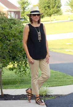 Stylist - like this classic casual black and tan. Love the shoes and ankle pant. Even like the necklace. Don't like the hat though