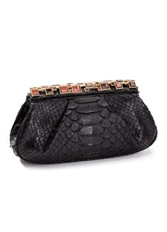 Python Clutch from the Darby Scott Art Deco Collection. Evening clutch crowned with red tiger eye accents in an art deco inspired toplock. Magnetic closure, fully lined, inside zipper compartment. Bla