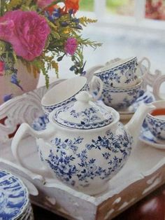Lovely blue and white flowered teapot, cups and saucers.