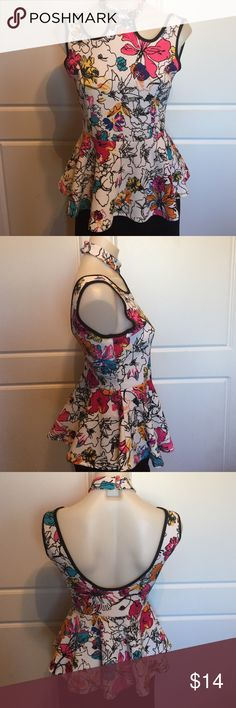 Carolina Floral Pattern Peplum Top New without tags. This top is perfect with a pencil skirt or jeans. Carolina Tops