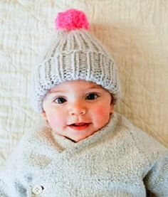 Super Soft and Simple Baby Hat - Keep your little angel's ears warm this winter with this Super Soft and Simple Baby Hat. This rib stitch baby hat knitting pattern is a simple beanie topped with a pom pom for an extra cute touch. You can whip up this quick knit in a jiffy when knitting in the round, making it a great last minute gift idea for baby showers.
