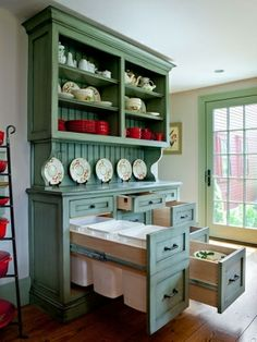 Custom painted and distressed hutch with extra deep drawers that protrude past the wall and under the stairs by cristina