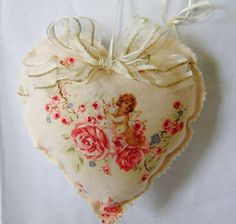 One in a range of very pretty hanging heart decorations, each one is different and can be made again on request. They all have different fabrics and embellishments, They have a polyester filling with a good measure of highly scented dried lavender mixed in.French linen, with Venise lace edge, and ma...