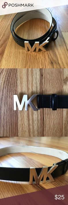 Michael Kors MK logo buckle belt Black leather belt by Michael Kors. Silver MK logo buckle. Great condition, only worn a few times. | No trades please MICHAEL Michael Kors Accessories Belts