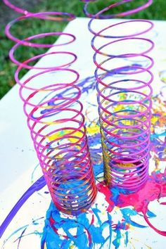 Action Art for Kids-Paint with Slinkys-Process art activity #daycareideas