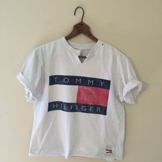 """Brand:+Tommy+Hilfiger Size:+N/A,+fits+like+boys+large+or+womens+small Length:+18"""" Width:+18"""" Sleeve+Length:+8"""" **+This+shirt+is+in+extremely+worn+distressed+condition.+Great+rugged+vintage+tee+with+HUGE+tommy+logo!+"""