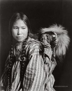 Madonna of the North. Inuit woman with papoose on back, Arctic Alaska. 1912
