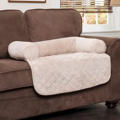 This ingenious bolstered couch protector doubles as a soft