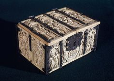 Marriage casket, 14th century. Artist Unidentified artist, French, 14th century French. Ivory casket with engraved silver mounts. Decorated with 15 reliefs, each depicting an amorous couple; on the lid 4, on the front 3 on each side 2 (the right hand with Tristan and Iseult watched by King Marke, and a couple playing chess). The silver straps engraved with long-necked dragons; engraved silver esutcheon over key-tablet, 16th-17th century. Panel and strap at left side broken.