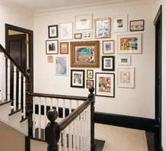 postcards, photos, and kids' artwork on the second floor landing