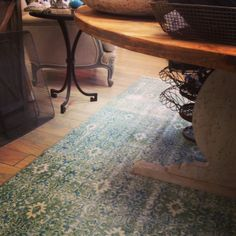 Vintage rug in green and blue -- looks good with just about everything in the store! -- under our rustic Swedish breakfast table #nomadictrading #weidnerhasou