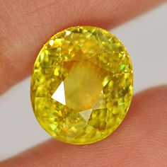 Charming Gem 5.34 Ct. Oval Natural Multi Color Titanium Sphene Rainbow Spark - These are the most beautiful I think. I am pretty much in love!