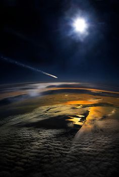Photo taken from an airplane window of a meteor