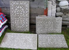 Rubber Door Mats pressed into a concrete mold and later removed, to make stepping stones. There are lots of other smart concrete project ideas on this page.