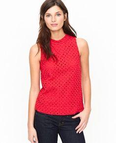 Simple sleeveless top with dark denim