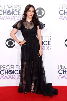 Kat Dennings goes somewhat gothic in a black, Ludmila Corlateanu gown with plenty of romantic, sheer details.