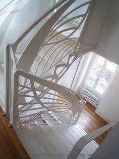 Escalier design double quart tournant Art Nouveau papillon, dessiné et mis en forme par Jean Luc Chevallier pour La Stylique.