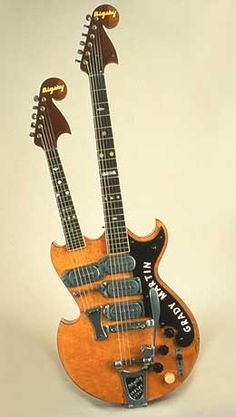 Bigsby Double Neck, 1952 This Paul Bigsby guitar, custom-made for country singer Grady Martin, has a standard six-string neck coupled with a five-string mandolin neck.