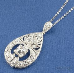 Art Deco Platinum and Diamond Pendant, designed as a drop, set with an old European-cut diamond and full and single-cut melee, millegrain accents, suspended from delicate chain, lg. 1 1/4, 14 7/8 in.