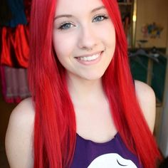 Beautiful bright red hair color shown by our DIY dye fashion girl