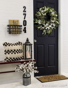 Are you bored of your front door but don't want to pay for a new one just yet? Check out these ideas on how to update your front door! You can save money while also making your front porch look new again!