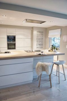 what color Kitchen White pastel blue wood worktop scandinavian