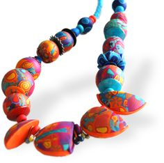 Yikes Colors - Etsy The cut, partial beads are such an fascinating design concept.