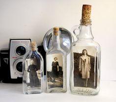 Vintage photos displayed in old glass bottles.