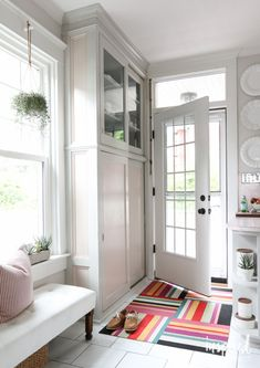 White Kitchen with Multi Color Entryway Rug | Summer Home Tour via @inspiredbycharm