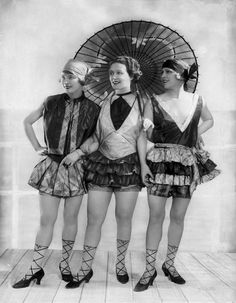 A Berlin cabaret act, 1927 * the laces on the shoes look painted onto their legs (doable!).