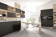 Hacker 6000 Black satin lacquer.  Cooking, eating and celebrating together: the kitchen has long replaced the living room when it comes to exciting evenings with your closest friends. Apart from the  refrigerator, the most important feature is an intelligent table solution. #kitchen #inspiration #modern #contemporary #german #black #satin #ideas #stunning