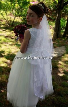 Pegeen Flower Girl Dress Style 672 Anne from the regal Collection - Tulle and pearl trellis silk in Pink, ivory, white or gold. Colors are limited for top but may be any color on the bottom. Includes Bolero Jacket and Antique NOELLE Rose - 12 months to Plus Size Sleeveless only
