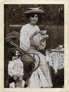 Actress Millie Legard drinking tea in her garden, United Kingdom, circa 1905