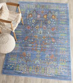 VAL108M Rug from Valencia collection.  This brilliant blue antique styled area rug, VAL108M, by Safavieh, with florals and ferns in vivid rust, gold and green hues finished in an heirloom patina.