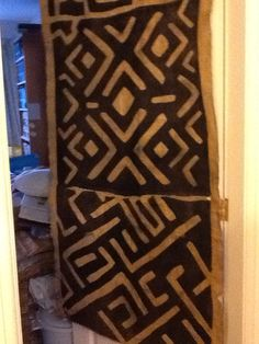 Enormous 3 section Kuba Cloth (west africa) that I got in Kenya.  Feeling slightly stressed about finding a 'forever home' for it on a wall in the New House. In meantime it can hang over a door like it does at the moment - but ONLY if not in direct sunlight. I think this one is going to be quite tricky! And anyway it needs mounting and not well enough to at moment.