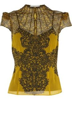 I love this Karen Millen Lace Print Blouse. The print is done very nicely. Try this with a black tulip skirt and wedges. Fab :)