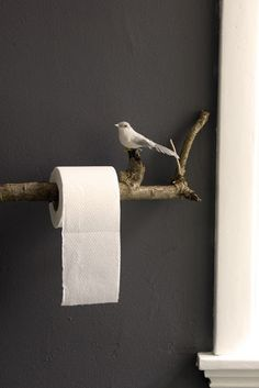 creative home decor.  Cutest TP holder as a bird & branch.