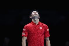 Kei Nishikori of Japan reacts during the men's singles match against Marin Cilic of Croatia on day six of the ATP World Tour Finals at O2 Arena on...