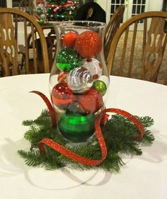 Exciting Christmas Table Arrangements Ideas With Red And Green Crafts And Candys At Cool Unique Glass At White Dining Clothes Also Rustic Chairs Inspiring Concepts