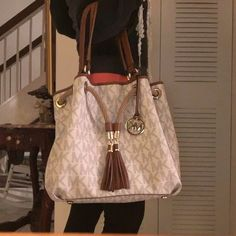 Michael Koss large tote Large MK tote no pockets i side  it has a key holder on the inside Michael Kors Bags Totes