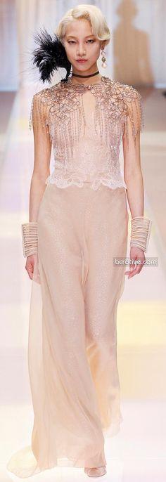 Giorgio Armani Privé Fall Winter 2013-14 Haute Couture.  Pretty cream gown with chain detail at the shoulders