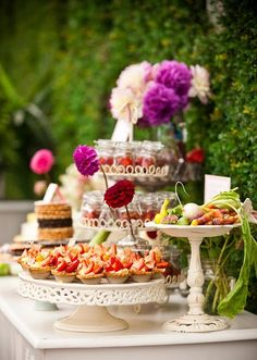 Garden Party Ideas - add interest to your food table by displaying plates at different heights -lovely! #gardenparty #foodpresentation