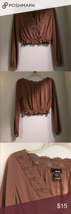 Long Sleeve Lace/Crochet Crop Top Long sleeve crop top in a dusty-purple color with floral crochet detail and ruffle elastic waistband. Worn once. In great condition. Light comfortable material. Wet Seal Tops Crop Tops