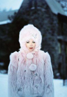 Bjork in faux pink furry coat.