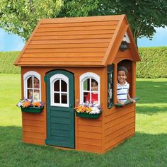 The Bancroft Wooden Playhouse by KidKraft is everything your child needs to create a magical world of his or her own. Large enough for up to three children yet compact enough to tuck into a shady backyard nook, Bancroft is crafted with a keen eye to archi Outside Playhouse, Build A Playhouse, Playhouse Outdoor, Wooden Playhouse, Playhouse Kits, Simple Playhouse, Costco Playhouse, Cubby Houses, Play Houses