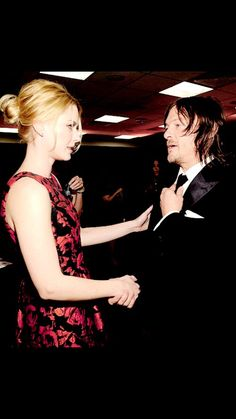 Alexandra Breckenridge and Norman Reedus attend AMC's 'The Walking Dead' season 6 fan premiere event at Madison Square Garden on October 9, 2015 in New York City.