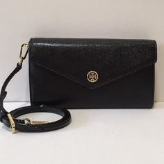 Tory BURCH Robinson Clutch/Crossbody NWT Brand new with tags authentic Tory BURCH Robinson Combo Clutch/crossbody purse. Beautiful shiny brushed leather material and tons of internal storage space. The wonderful feature about this bag is the detachable strap that turns this crossbody into a clutch! Tory Burch Bags Crossbody Bags