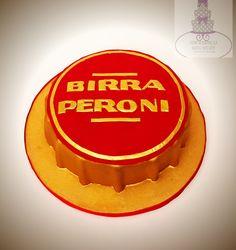 Peroni bottle cap cake #bari #cakedesign #cake #birthday #suitcake #tortaexpress #festedicompleanno #party  #fondant  #cakelover #sugarartist #sugar #topcake #cakedesigner #sugarpaste #fondantcake #gumpaste #peroni #beercap